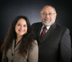 Attorneys Eduardo M. Madrid, Esq. and Erica L. Madrid, Esq.